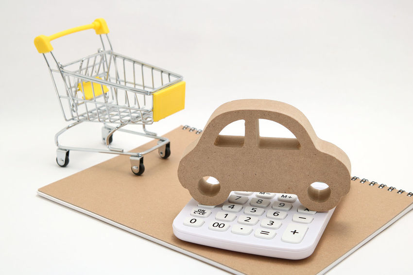 Automobile Budget Market Shopping Cart Toy Car Transportation Trolly Wheelbarrow Automotive Calculation Calculator Calculator Machine Cart Cost Drive Finance Insurance Miniature My Car No People Studio Shot Toy Trolly Car Vehicle White Background