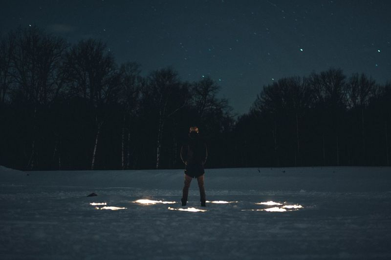 Man Standing Field At Night During Winter