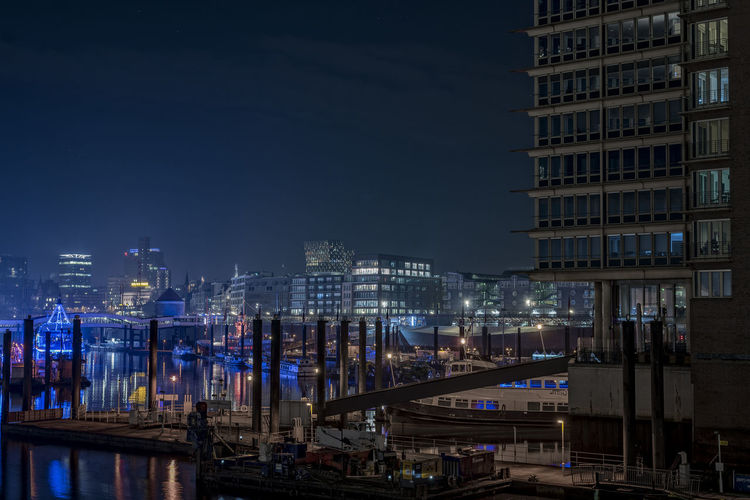 Kehrwiederspitze Architecture Artifical Lightning Blue Lights  Boats Building Exterior Built Structure Business Finance And Industry City Cityscape Downtown District Elbe River Hamburg Hamburg Harbour Illuminated Kehrwiederspitze Landungsbrücken  Night Outdoors Pontons Ships Sky Skyscraper Travel Destinations Urban Skyline Überseebrücke