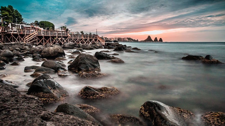 Sunset in Sicily Acitrezza  Catania Cityscape Coastline Holiday Italia Landscape Photography Sicily Sunset_collection Tourist Tourist Attraction  Vacations Beach Clouds Coast Italy Italy❤️ Landscape Landscape_photography Stones Sunset Tourism Vulcano Water Waves