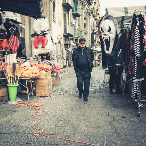 Italy❤️ Italian City Streetphotography Street One Person City Men Full Length Retail  Architecture Day Standing Rear View Real People Casual Clothing Occupation Building Exterior Clothing Footpath Adult Outdoors Lifestyles Street Market Walking Market Frightening Frightened  Scream Mask Horror Halloween Funny The Art Of Street Photography