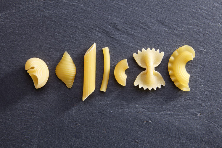 Directly above shot of various pastas on slate