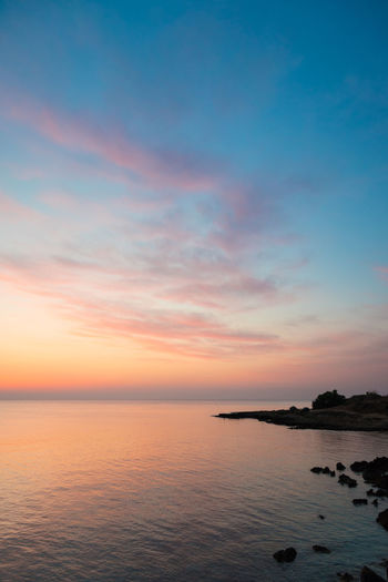 Rocky sea coast right before sunrise Beach Beauty In Nature Day Horizon Over Water Nature No People Orange Color Outdoors Purple Scenics Sea Sky Sunset Tranquil Scene Tranquility Vivid Water