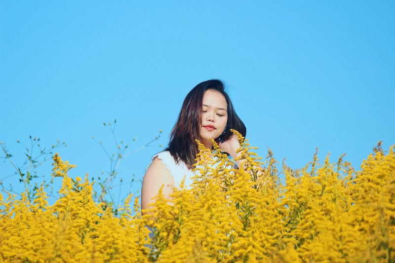 Be better. Nature Photography Naturelovers Beautiful Portrait Of A Woman Portrait Portrait Photography portrait of a friend Sightseeing Autumn colors Autumn Yellow Flower One Person Plant Flowering Plant Young Women Leisure Activity Sky Lifestyles Young Adult Real People Beauty In Nature Growth Nature Blue Land Clear Sky Hairstyle Hair Long Hair