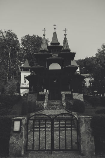 Architecture Black Black And White Blackandwhite Building Exterior Built Structure Chapel Church Culture Day Entrance Exterior Façade Footpath History No People Outdoors Sky Sovata Spire  Tourism Tranquility Transylvania Travel Destinations Tree