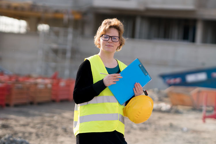 Portrait Of Female Architect Working At Construction Site