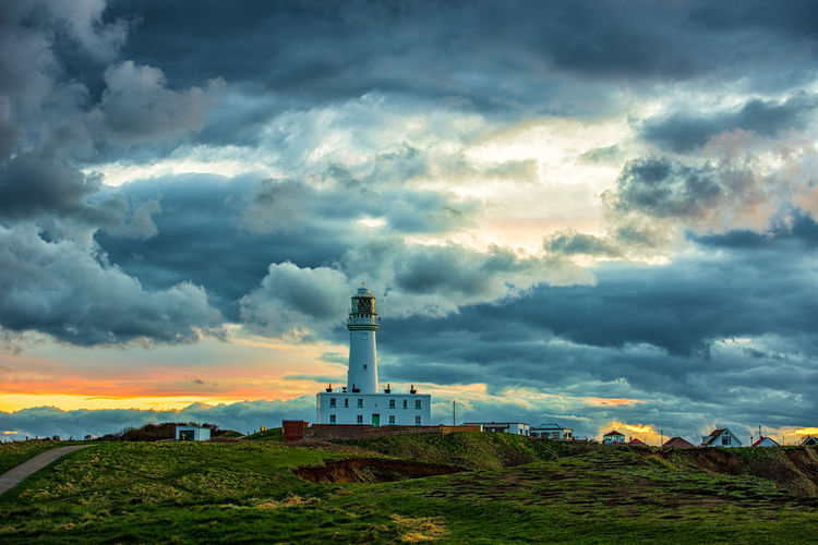 Architecture Beauty In Nature Building Building Exterior Built Structure Cloud - Sky Direction Environment Field Guidance Land Landscape Lighthouse Nature No People Outdoors Plant Scenics - Nature Sky Tower