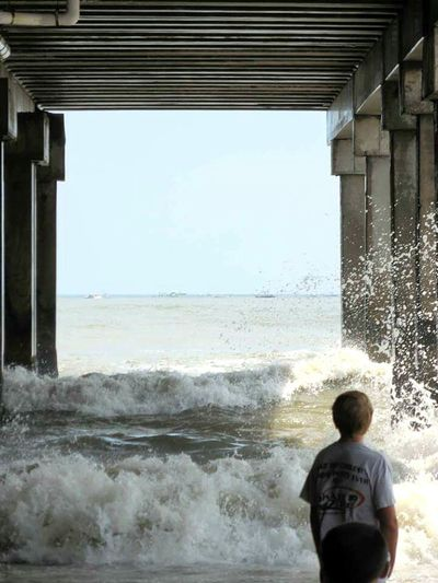 Watching the waves. Beach Motion Outdoors Nature Child Newjersy Waves Underthepier Njshooterz Njshore Photooftheday Nature Photography EyeEm Gallery Photography Boy