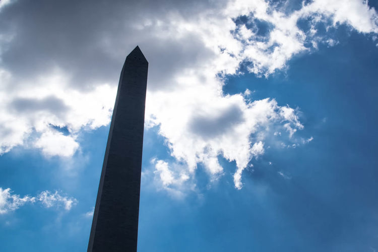 Cloud - Sky Sky Low Angle View Nature Architecture Blue Tall - High No People Built Structure Day Outdoors Building Exterior Sunlight Memorial Environment Metal Monument Tower Shape Business Architectural Column Directly Below Pollution