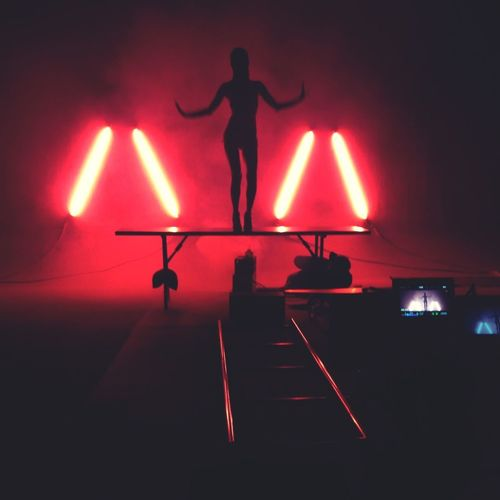 Woman performing on illuminated stage