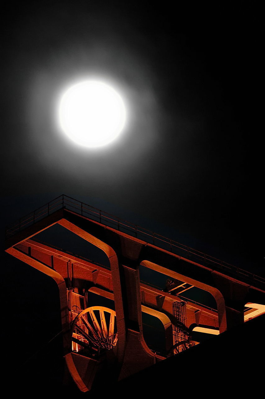 sky, night, illuminated, no people, architecture, moon, built structure, nature, low angle view, outdoors, light - natural phenomenon, circle, full moon, glowing, lighting equipment, shape, building exterior, geometric shape, orange color, moonlight