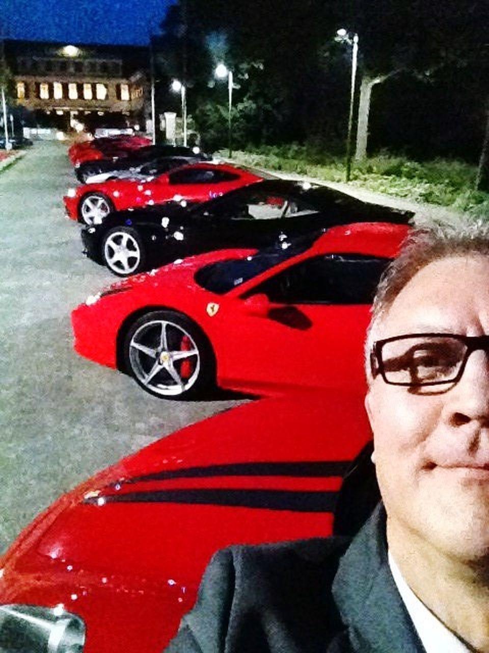 PORTRAIT OF MAN WEARING RED CAR