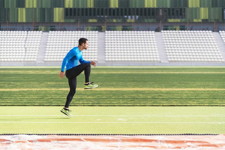 Full length of man playing soccer