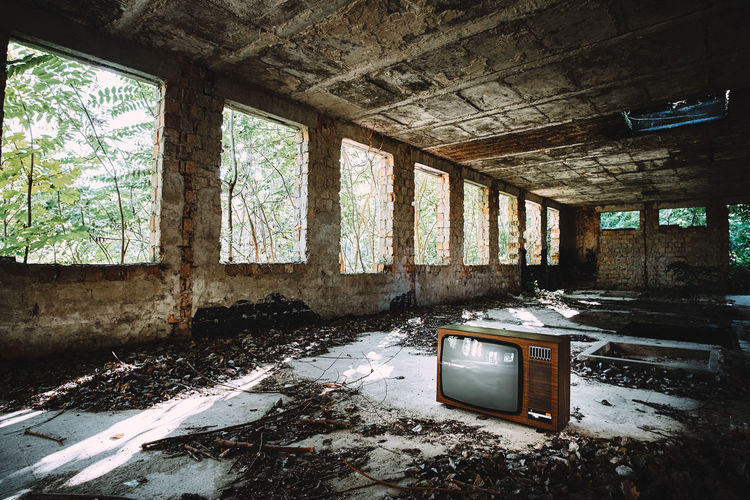 Retro Vintage Television Abandoned Architecture Bad Condition Building Built Structure Ceiling Damaged Day Decline Deterioration Domestic Room Indoors  Messy No People Obsolete Old Old Television Ruined Run-down Vintage Weathered Window