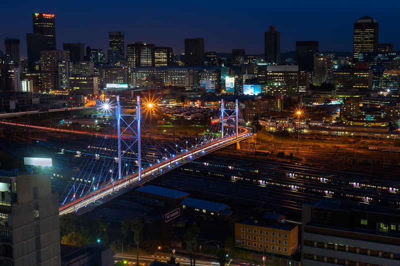 Downtown Johannesburg, looking across the Nelson Mandela Bridge after sunset Illuminated Building Exterior Architecture Built Structure City Night Cityscape Building Office Building Exterior Transportation City Life Sky Connection High Angle View No People Skyscraper Residential District Bridge Nature Modern Bridge - Man Made Structure Outdoors Johannesburg South Africa Nelson Mandela Bridge Downtown Night Photography Long Exposure Business Business District