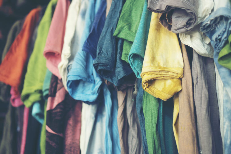 Close-up of clothes hanging at market stall