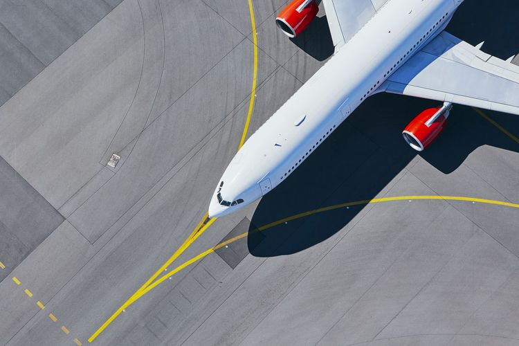 High angle view of airplane at airport runway