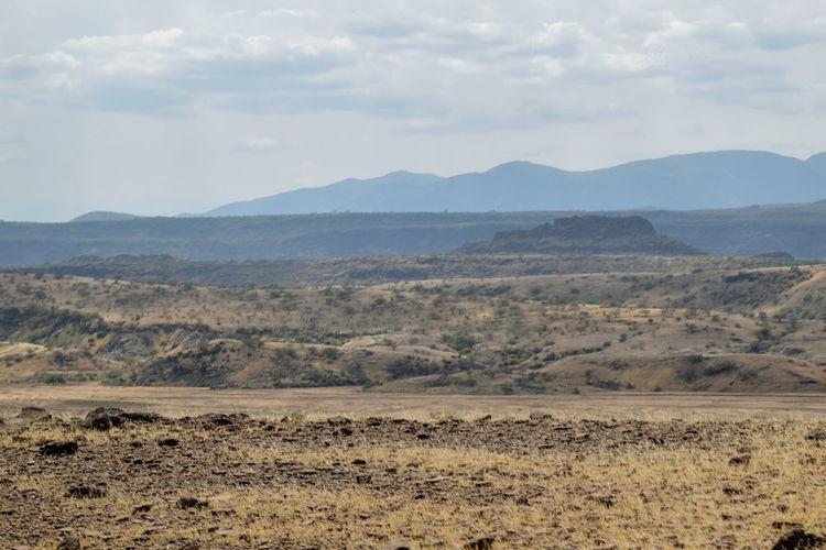 Arid landscapes against sky in rural kenya, magadi, rift valley, kenya
