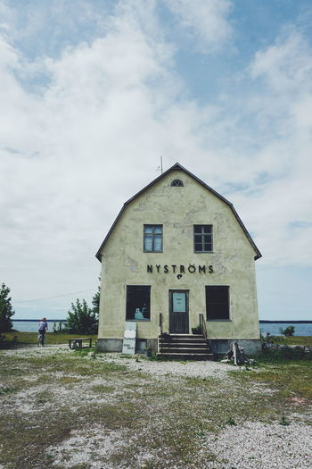 Café Nyströms, Burgsvik , Sweden Architecture Building Exterior Built Structure Burgsvik Cloud - Sky Day Gotland Gotland, Sweden Grass House Nyströms One Person Outdoors People Real People Sea Sky Summer Sweden Sweden Nature Travel
