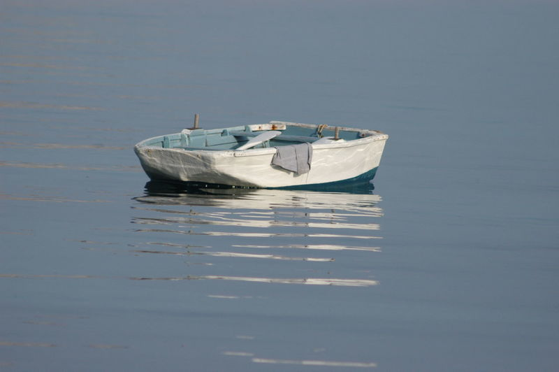 #Dingy Boat Day Mode Of Transport Moored Nature Nautical Vessel No People Outdoors Reflection Sea Transportation Water Waterfront