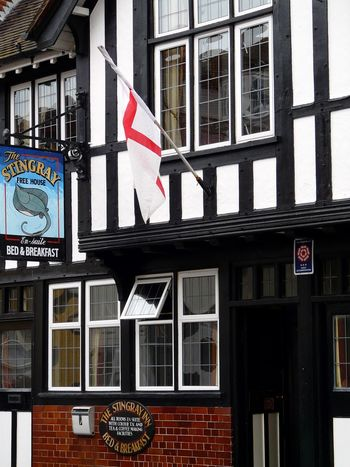 The Stingray pub - Harwich Town, Essex, England Architecture Building Exterior Built Structure Communication Day Flag Food And Drink Establishment Harwich Town No People Outdoors Patriotism Public House Road Sign Text The World Before Bin Laden Window