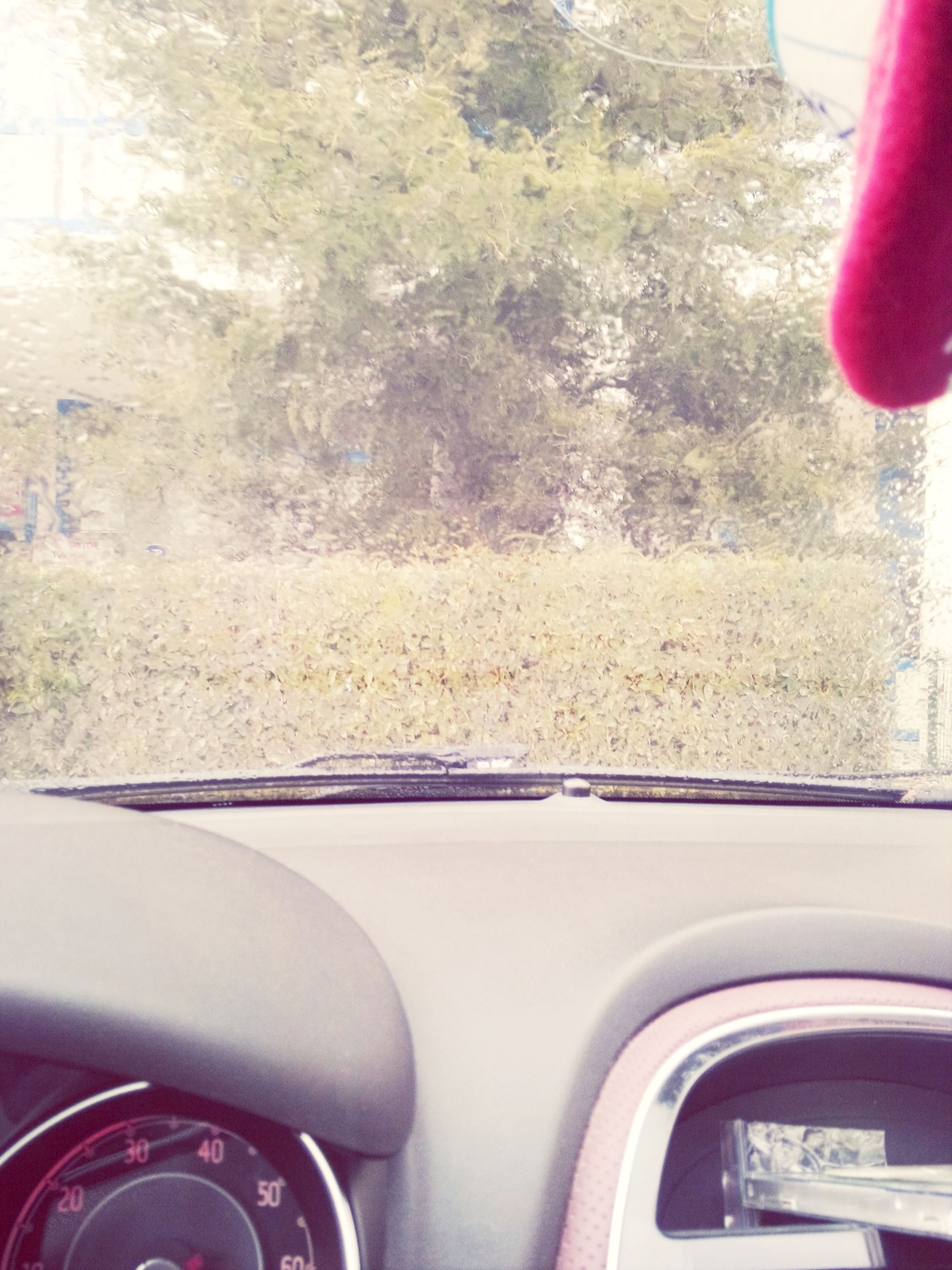 transportation, mode of transport, car, land vehicle, vehicle interior, part of, car interior, windshield, road, cropped, glass - material, transparent, window, close-up, street, travel, no people, day, red, indoors