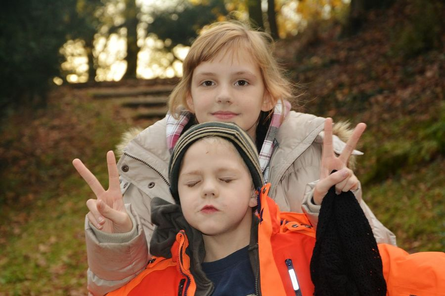 Peace... Child Looking At Camera Childhood Children Only Outdoors People Leisure Activity Blond Hair FunTimes! Funny Face Fun! Brother And Sister Real People Funtimes Fun Funny Faces Bonding Love Boy Lustigunterwegs. Two People Girls Cute Brother And Sister (: Happiness