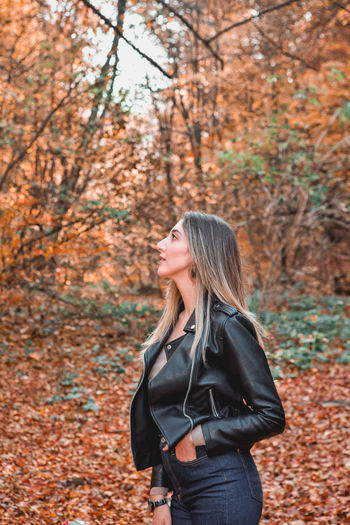 Woman standing in park during autumn