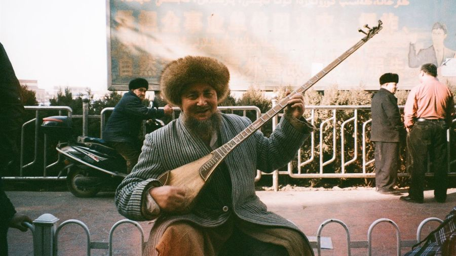 Street performers in Uygur elderly. #photographic film by Olympus The Street Photographer - 2017 EyeEm Awards