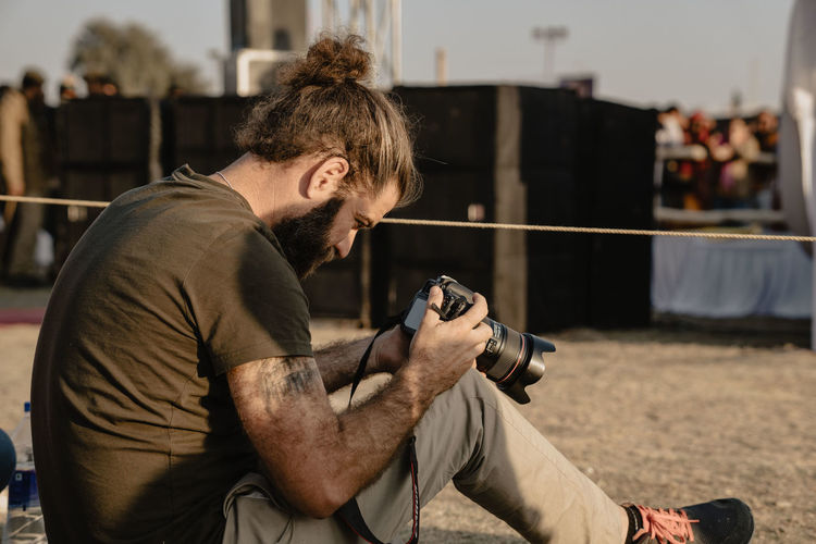 Side view of man photographing