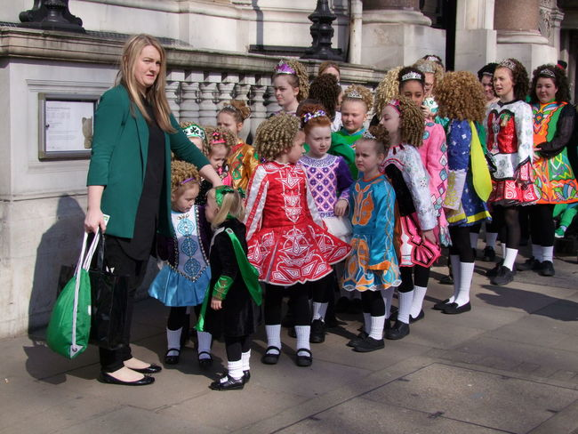 Children waiting their turn with anxious teacher Bonding Children Colorful Costumes Dancers Day Friendship Front View Full Frame Full Length GB Girls Happiness Leisure Activity Lifestyles London Looking At Camera Outdoor Photography Real People Saint Patrick's Day Parade Smiling Standing Togetherness TROUPE Urban