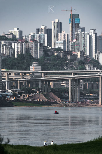 City Cityscape Urban Skyline Modern Water Skyscraper Sea Downtown District Sky Architecture Cable-stayed Bridge Bridge - Man Made Structure Steel Cable Elevated Road Underneath