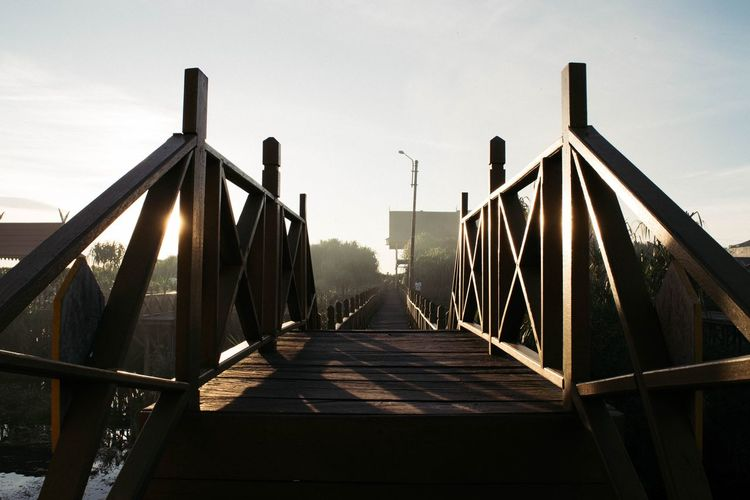 075 : Little Bridge The Way Forward Clear Sky Architecture Diminishing Perspective Long Day Outdoors Narrow Vanishing Point Sky Tranquility Tall Sun Boardwalk Surface Level No People