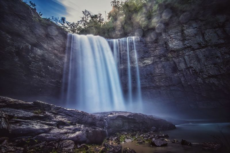 The Great Outdoors - 2017 EyeEm Awards Waterfall Motion Long Exposure Water Flowing Water Scenics Beauty In Nature Nature Outdoors Blurred Motion Rock Formation Rainbow Rock - Object Day Tree No People Cliff Travel Destinations Power In Nature Low Angle View Georgia Landscape Mountain Tranquility