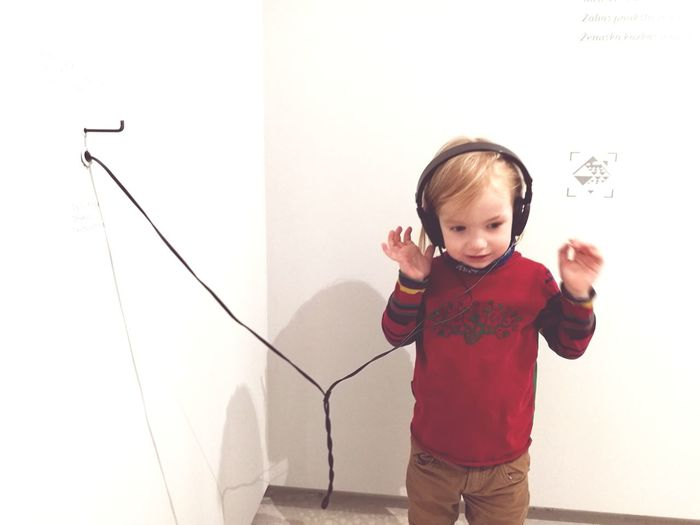 Childhood Standing One Person Drawing - Activity Indoors  Child Front View Children Only People Learning Smiling Listening Music Earphones Boy Listen