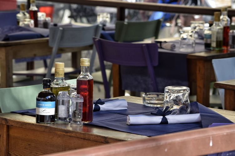 Table Setting Table Close-up Indoors  Day No People Visit Italy Florence Italy Street Photography Restaurant Piazza Santo Spirito Lifestyles Dining Table Glasses Bottles Chairs Napkin The Week On EyeEm
