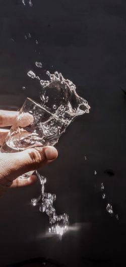 Close-up of hand holding water splashing