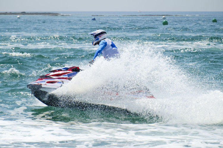Adventure Beauty In Nature Day Extreme Sports Horizon Over Water Jet Boat Leisure Activity Lifestyles Men Motion Nature One Person Outdoors Power In Nature Real People Sea Skill  Sky Splashing Sport Vacations Water Watercraft Waterfront Wave
