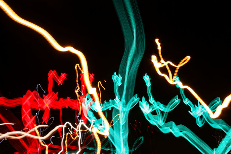 Black Background Close-up Glowing Illuminated Light Trail Long Exposure Motion Multi Colored Neon Night No People Outdoors Red Speed Technology