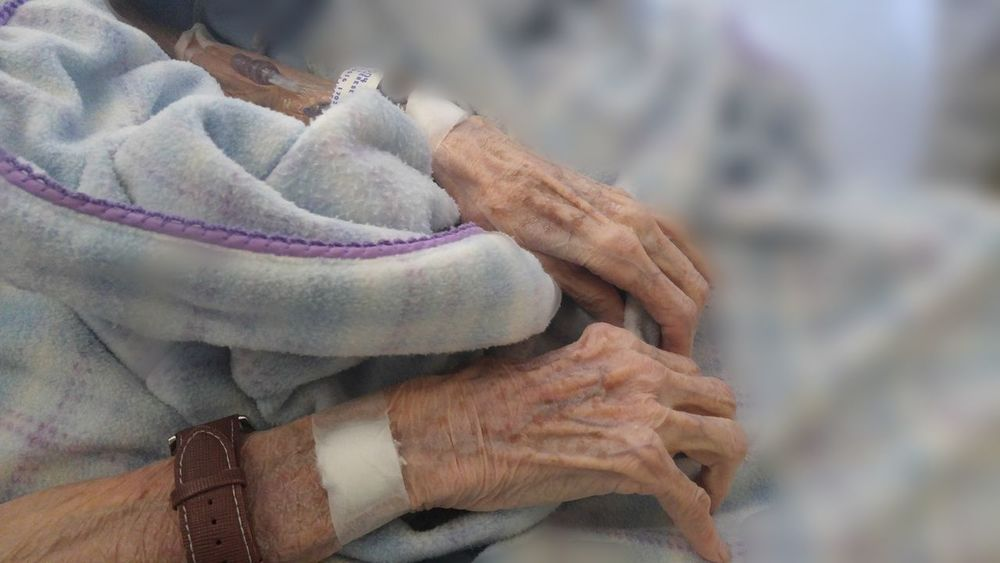 Elderly patient hands Arms Intravenous Medical Clinical Medicine Emergency Social Issues Transfusion Sick Patient Facility Elderly Community Senior Hands Hospital Blood Isolation Lonely Alone Care Intensive Premium Collection Getty Images