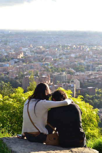 Architecture Bogotá Bonding Built Structure City Cityscape Clear Sky Colombia Couple - Relationship Day EyeEm Gallery Eyeemcollection Leisure Activity Lifestyles Love Outdoors Peolpe People And Places People And Places. Person Rear View Sitting Togetherness Young Couple