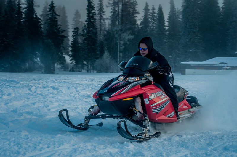 Action Cold Temperature Day Freezing Leisure Activity Mountains Nature One Person Outdoors Slovakia Snow Snowmobile Snowmobiling Winter