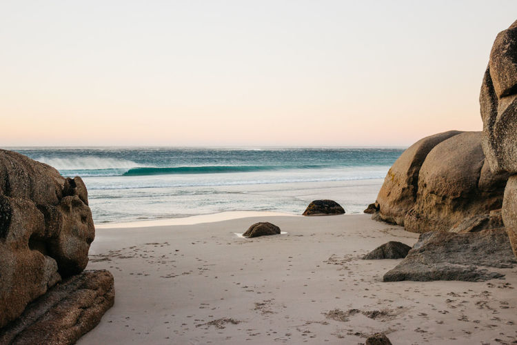 Alone on the Beach Cape Town Nature South Africa Surf Wave Beach Beauty In Nature Clear Sky Day Horizon Over Water Jonnynichayes Landscape Llandudno Minimalism Nature Outdoors Rock - Object Rocks And Water Sand Sea Shore Sky Sunset Tranquility Water