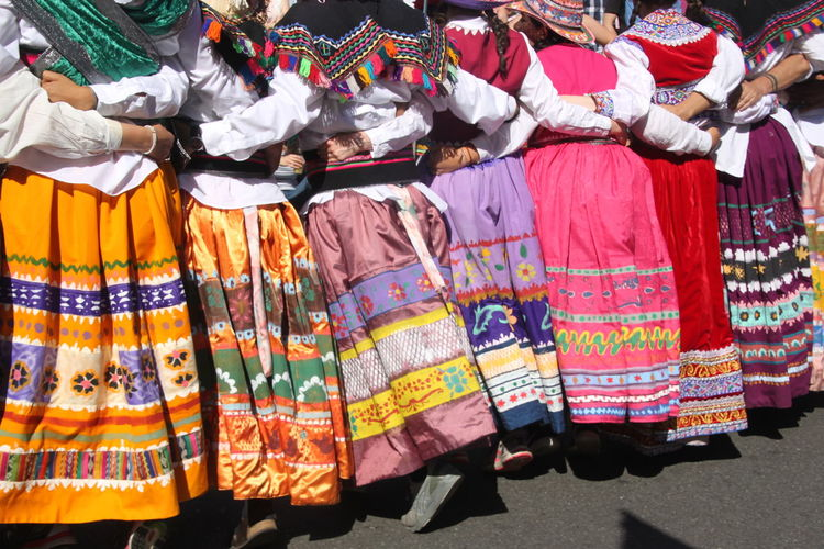 Women In Traditional Clothing Dancing On Road