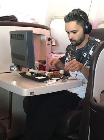 Young Adult First Class Traveling Business Class Dinner Virgin Atlantic