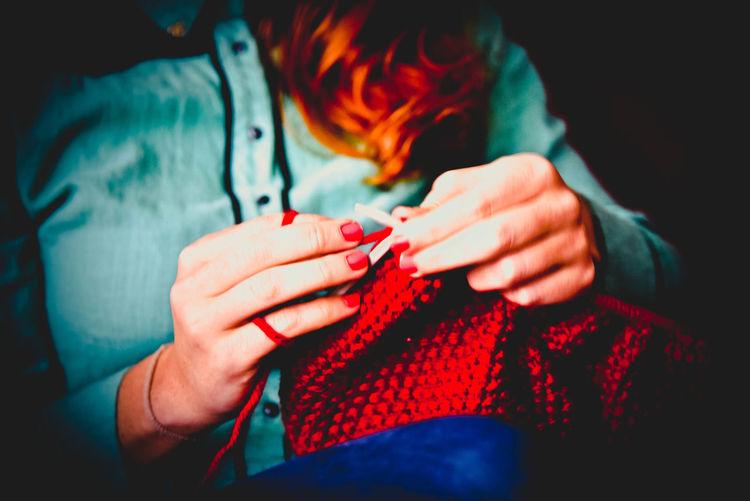 Close-up of woman knitting sweater