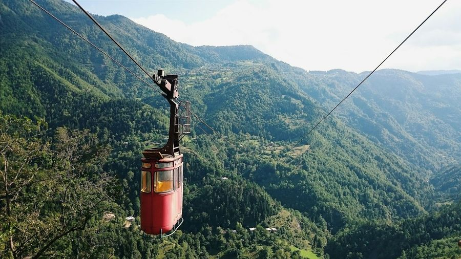 Overhead cable car over mountain