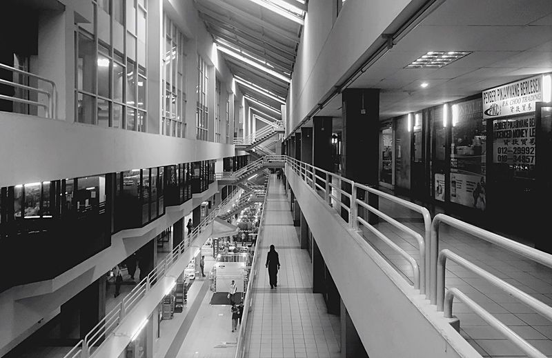 lonely. Shopping Mall Indoors  Modern Architecture Women Walking Retail  Illuminated People Open Edit Monochrome Streetphotography IPhoneography Lifestyles Adult Adults Only Business Finance And Industry Night Consumerism Futuristic One Person Library The Architect - 2018 EyeEm Awards
