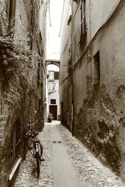 postcard like snapshot - bike in alley. Looks romantic Albenga Liguria,Italy Alley Architecture Black And White Photography Building Exterior Built Structure City Day House Italy❤️ No People Outdoors Residential Building Scriptina The Way Forward Walkway
