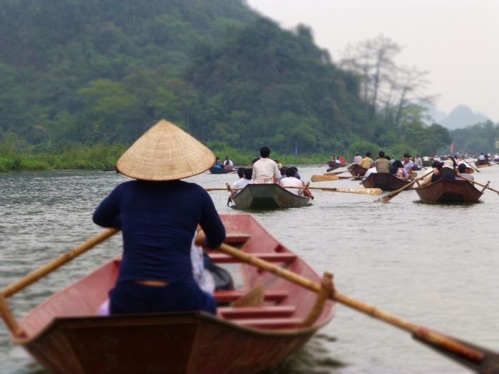 Perfume Pagoda Vietnam. All of the boat rowers are war widows Reflecting . Strong Women Perfume Pagoda